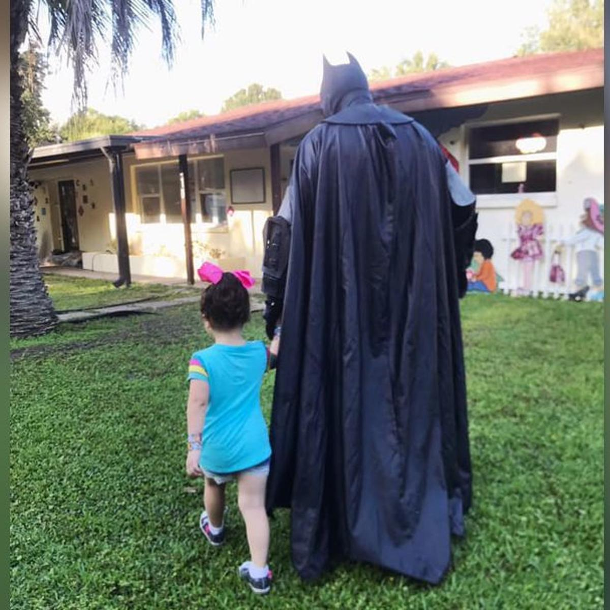 Batman walks bullied 3-year-old girl to school to help her
