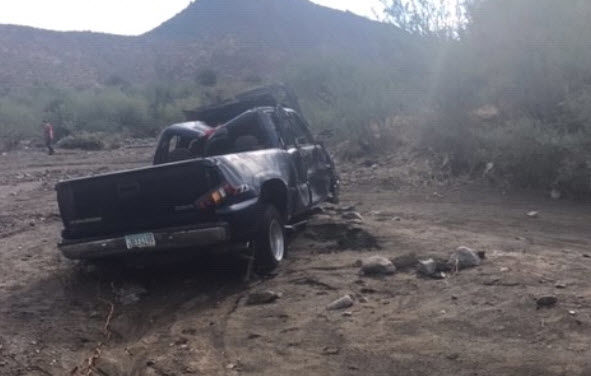 The sheriff's office got a 911 call that a truck with a man and woman inside had been caught in a flash flood in the wash.