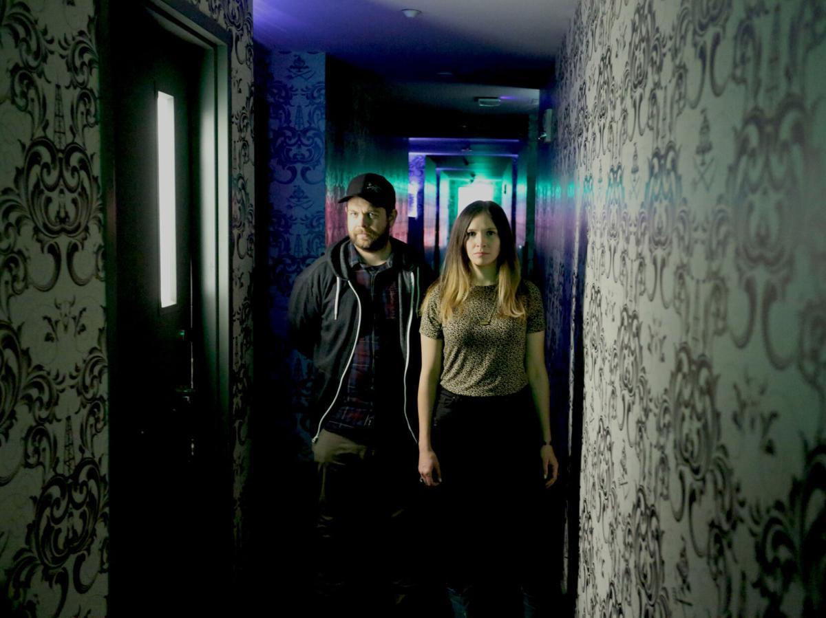 PortalsToHell218Jack-and-Heather-in-dark-hotel-hallway
