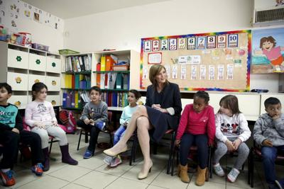 U.S. Ambassador to United Nations Power sits next to schoolchildren during her visit to the Hand in Hand, Center for Jewish-Arab Bilingual Education in Israel, in Jerusalem