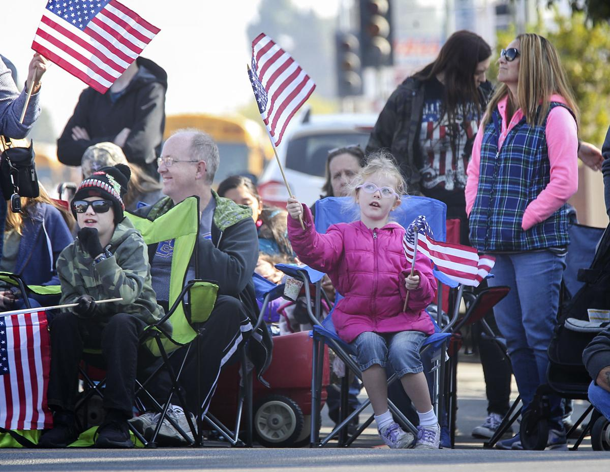 PHOTO GALLERY: Thousands line the streets for the Veterans Day parade