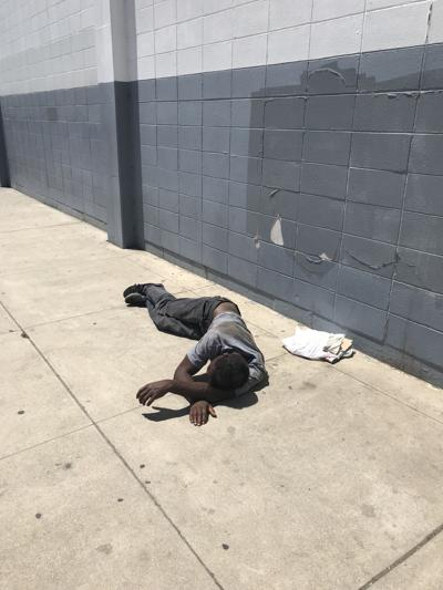 A homeless transient sleeps