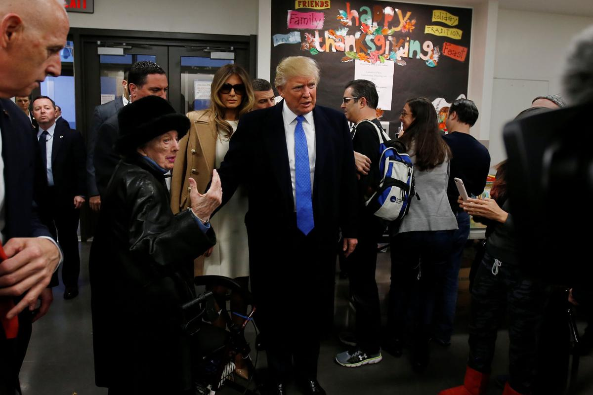 Republican presidential nominee Donald Trump arrives before voting at PS 59 in New York