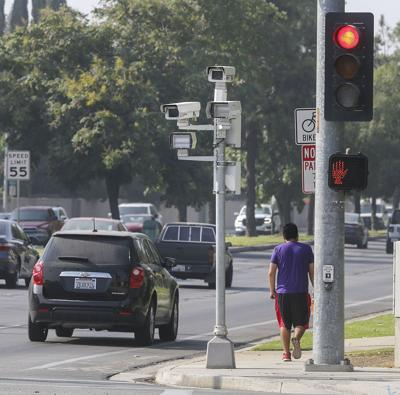 As red-light camera citations tripled in the last 10 years