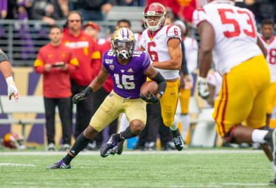 The University of Washington football team plays USC