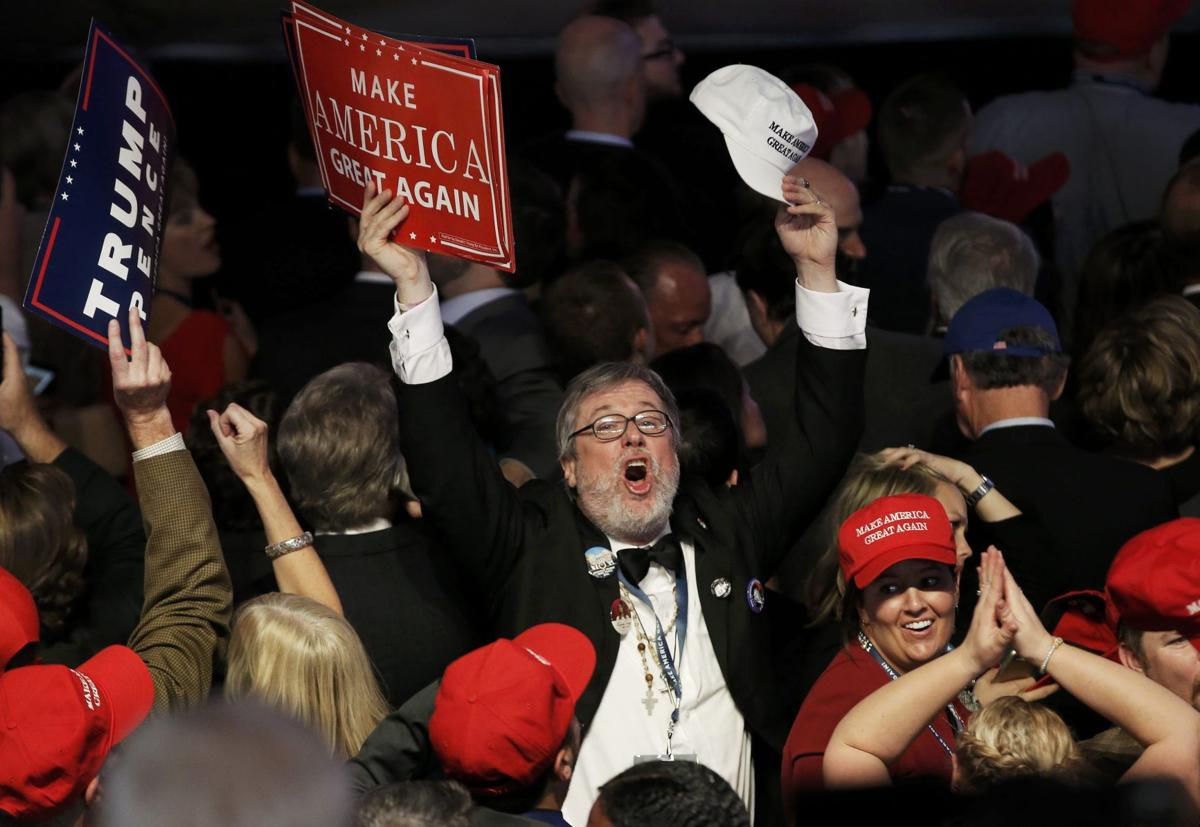 A supporter celebrates as returns come in for Republican U.S. presidential nominee Donald Trump during an election night rally in Manhattan