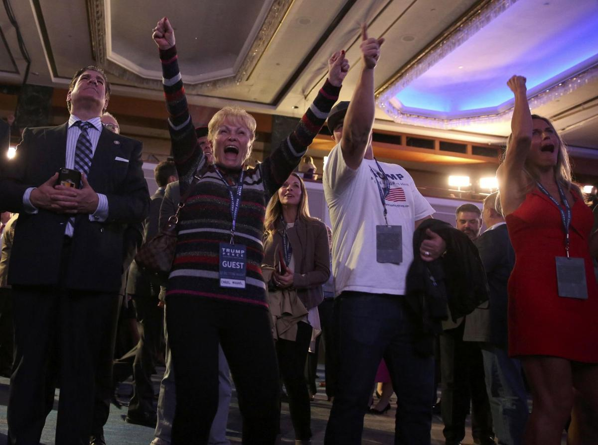 Supporters of U.S. Republican presidential nominee Donald Trump watch results at his election night rally in Manhattan