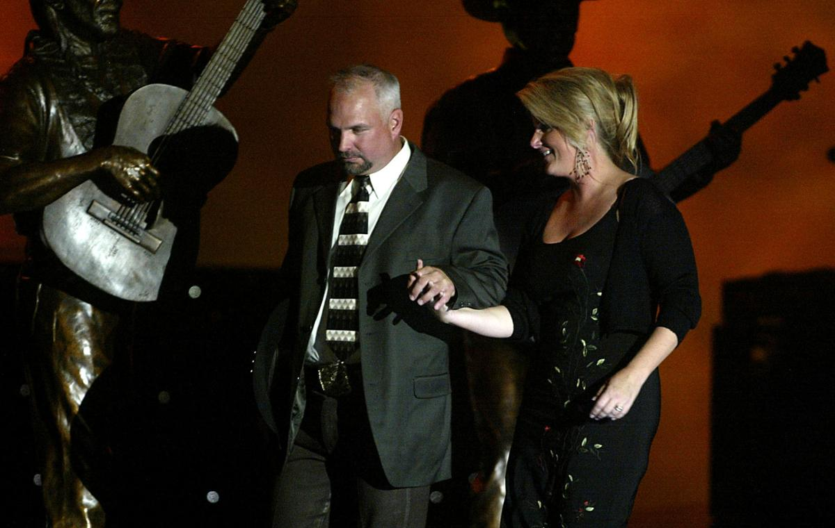 Legends in Bronze concertSurprise!Garth Brooks stunned the crowd of 7,000 at the Crystal Palace by hitting his knees and proposing to Trisha Yearwood Wednesday night