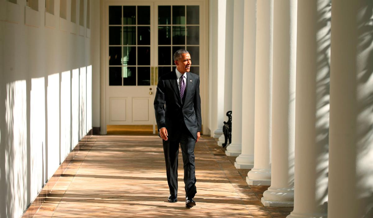 U.S. President Barack Obama walks the Colonnade toward the Oval Office of the White House in Washington on election day