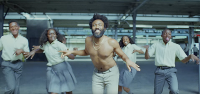 Two local dancers perform with Childish Gambino in