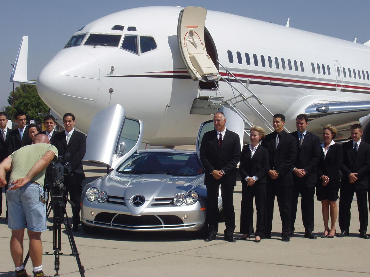 Crisp & Cole in front of a private jet