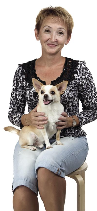 Image of the sitting old woman with dog