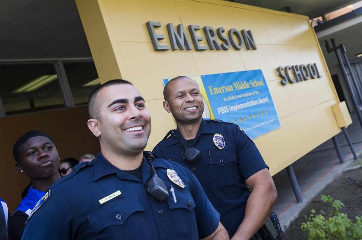 School resource officers Sandeep Malhi, left, and Charles Pratt at Emerson Middle  School. The officers will act as liaison for Bakersfield City School ...