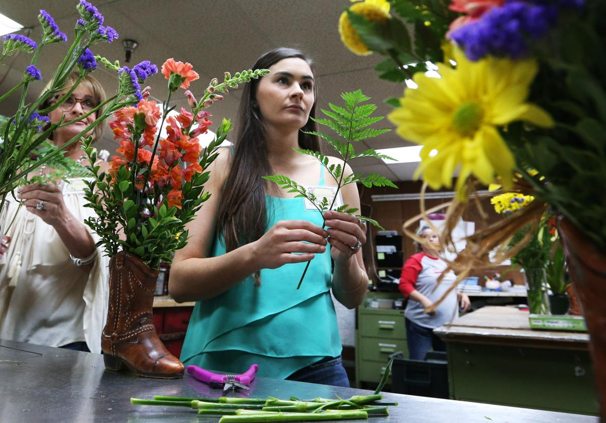 Kids Get A Kick Out Of Creating Flower Arrangements In