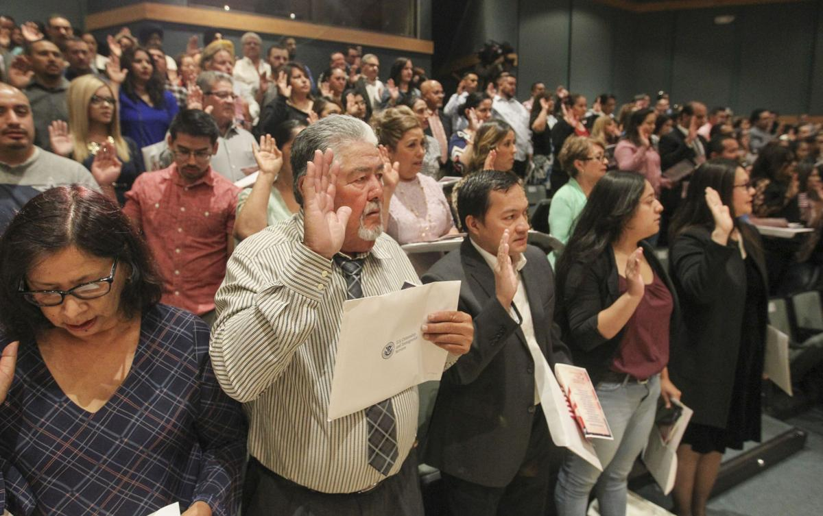 My voice can actually be heard now': New citizens sworn in at