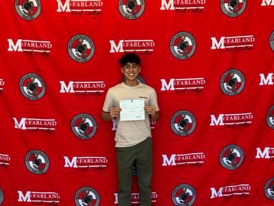 Joshua Rizo receiving Geo Group scholarship check.jpg