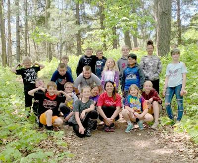 Fourth graders visit school forest, compose poetry