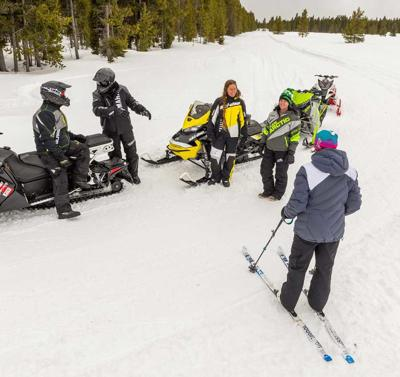 Invite a pal for Take a Friend Snowmobiling Week