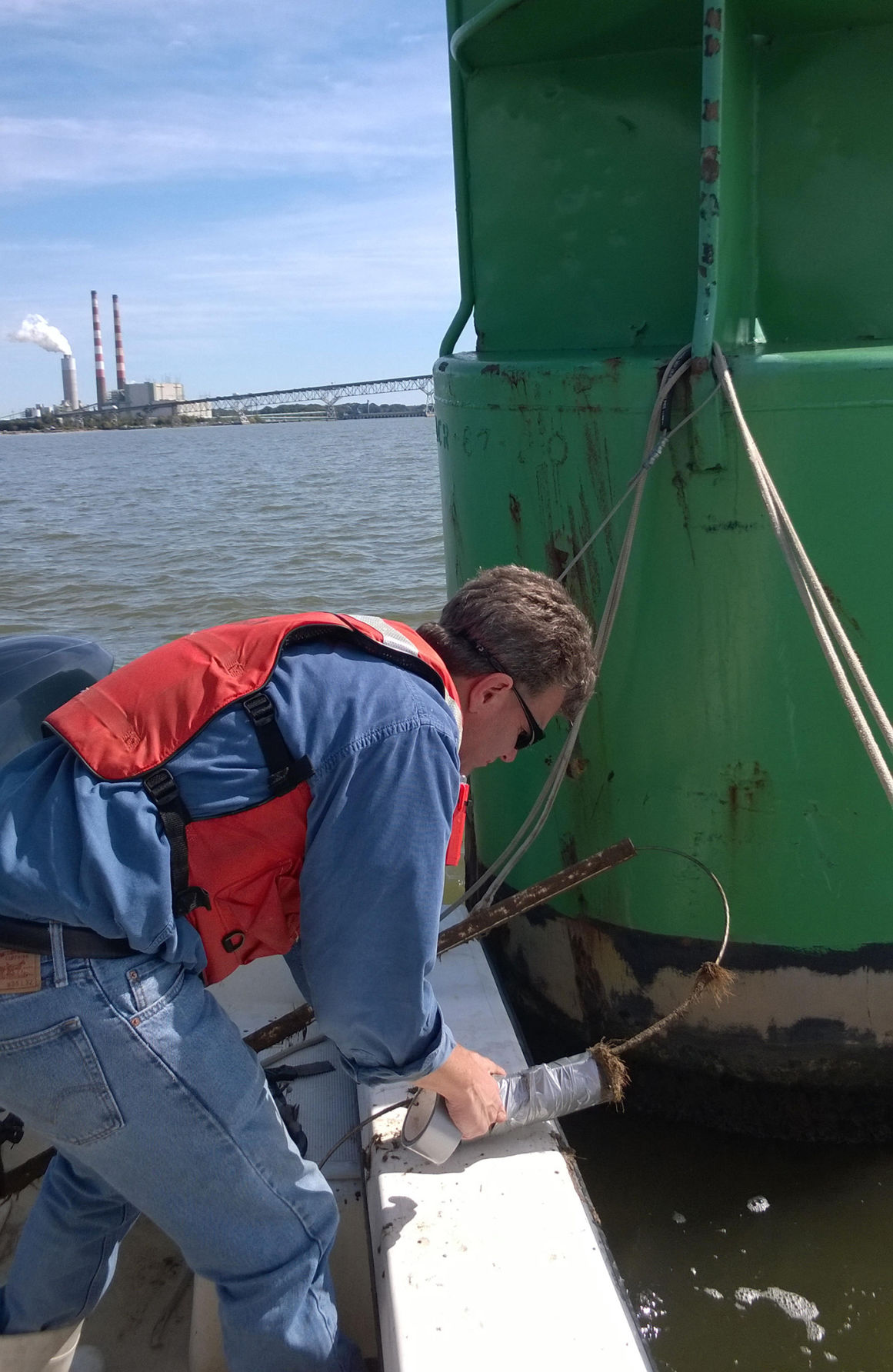 UMCES researcher at fish tracking buoy
