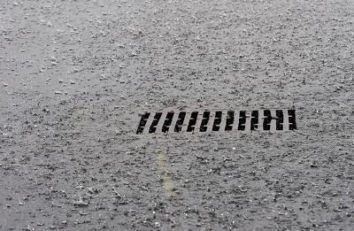 Storm drain in rain