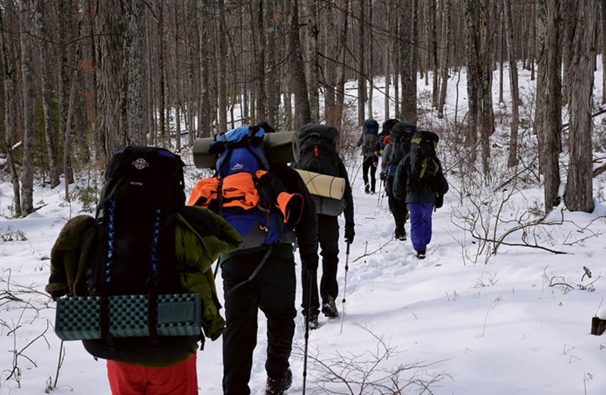 Winter backbackers in woods
