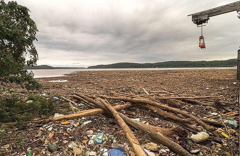 Debris removal behind Conowingo Dam
