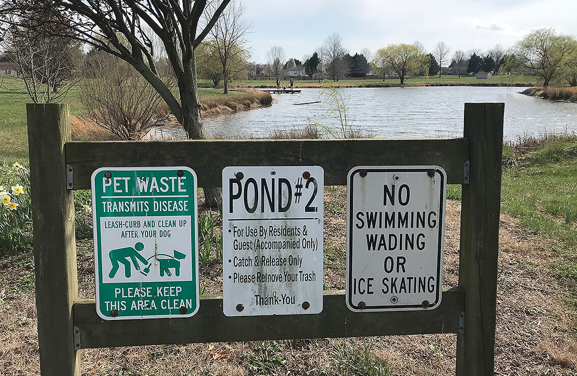Warning signs at stormwater management pond