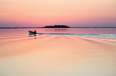 Skiff at sunset