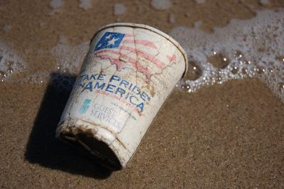 Discarded cup on sand