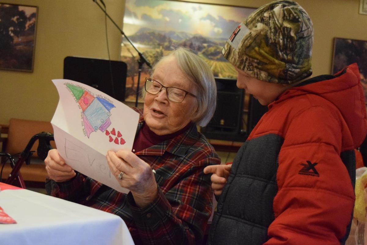 Dolores Bausum reads Valentine's Day card
