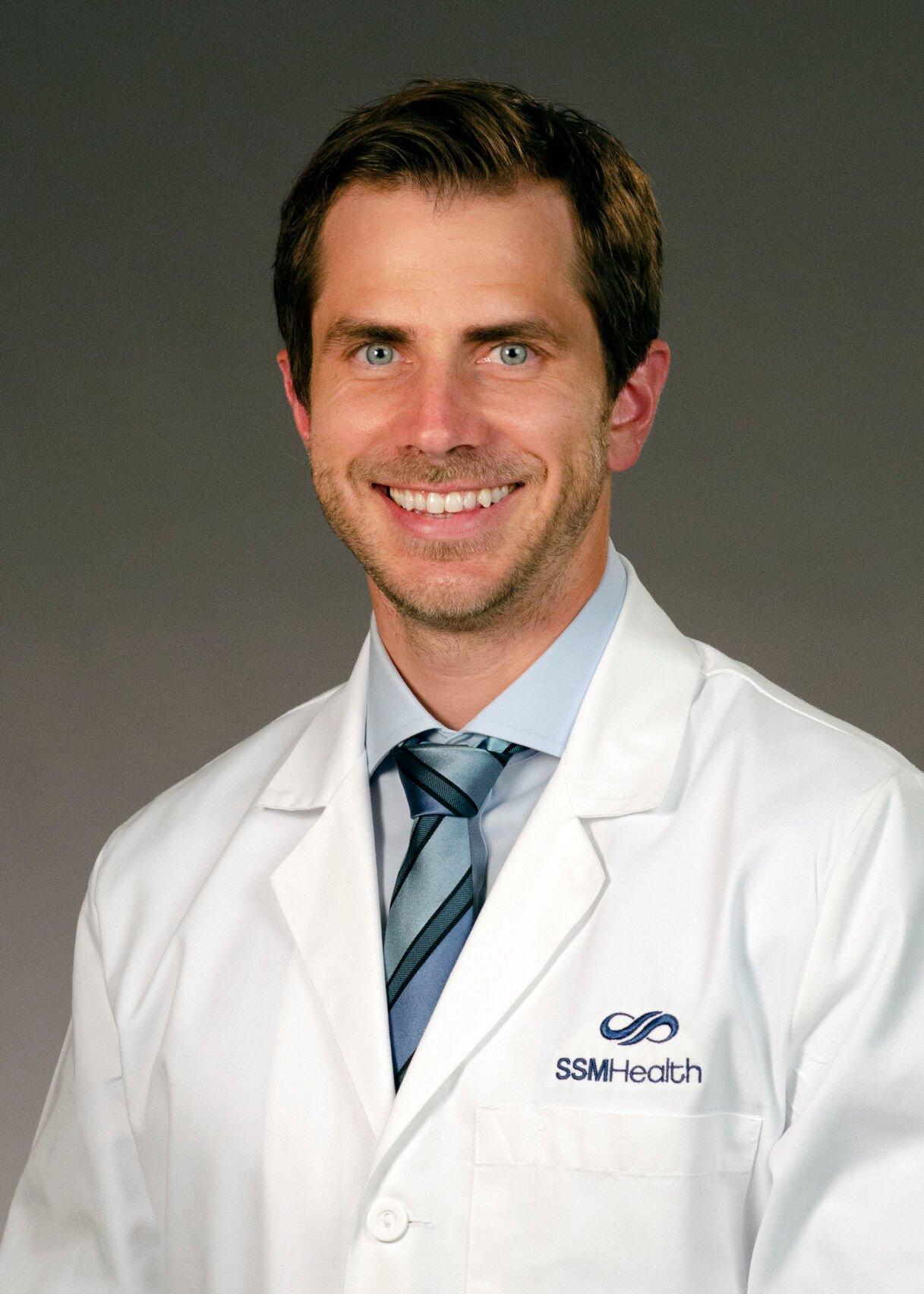 Dr. Adam Buhalog