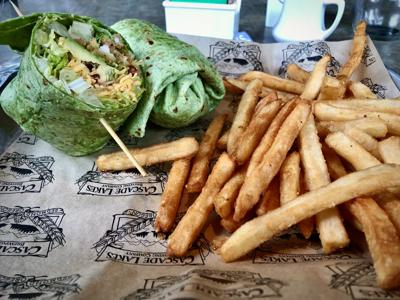 Crispy chicken wrap with a side of fries