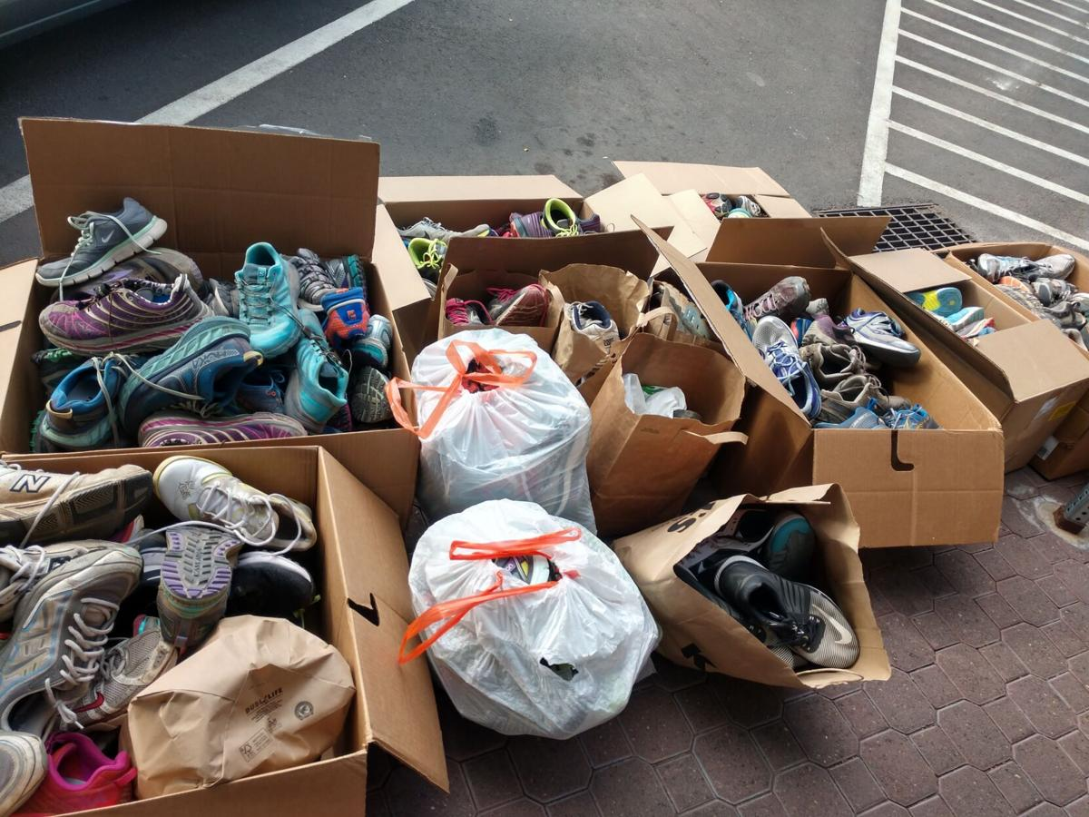 Boxes of Shoes Collected for Reuse.jpg