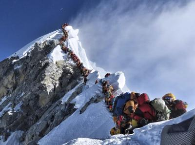 Nepal man shatters speed record for scaling world's tallest mountains