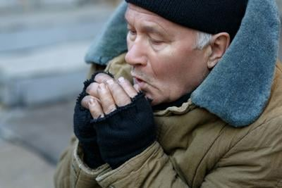 Homeless man is feeling cold.