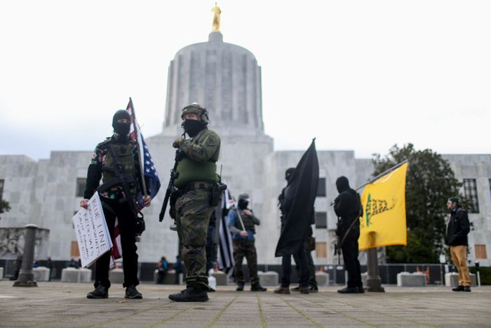 Heavy fortified statehouses around the U.S. see small protests