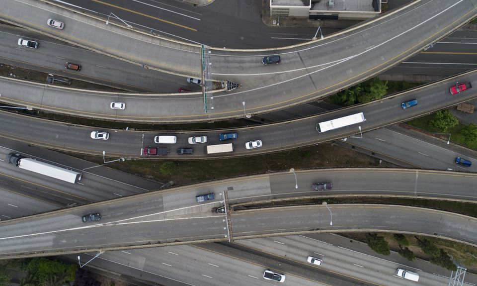 An aerial view of the I-5 and Morrison Bridge interchange in SE Portland during the evening rush hour on Wed., May 13, 2020.  Traffic, which had dramatically decreased in the early days Oregon's stay-at-home order, seems to have picked back up recently.  Dave Killen / Staff