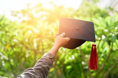 Graduates put out a black hat to express their joy.