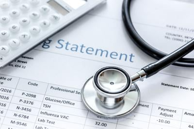 health care billing statement with doctor's stethoscope on stone background