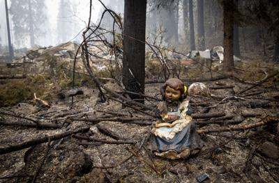 A statue of a girl reading sits in September near where the library in Blue River stood before it was destroyed in the Holiday Farm Fire.