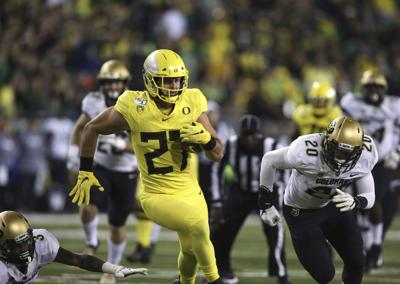 No. 13 Ducks ride run game, stout D to rout of Buffaloes