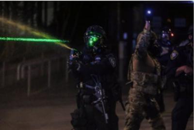 Man sentenced for shining laser at officer during Portland protest