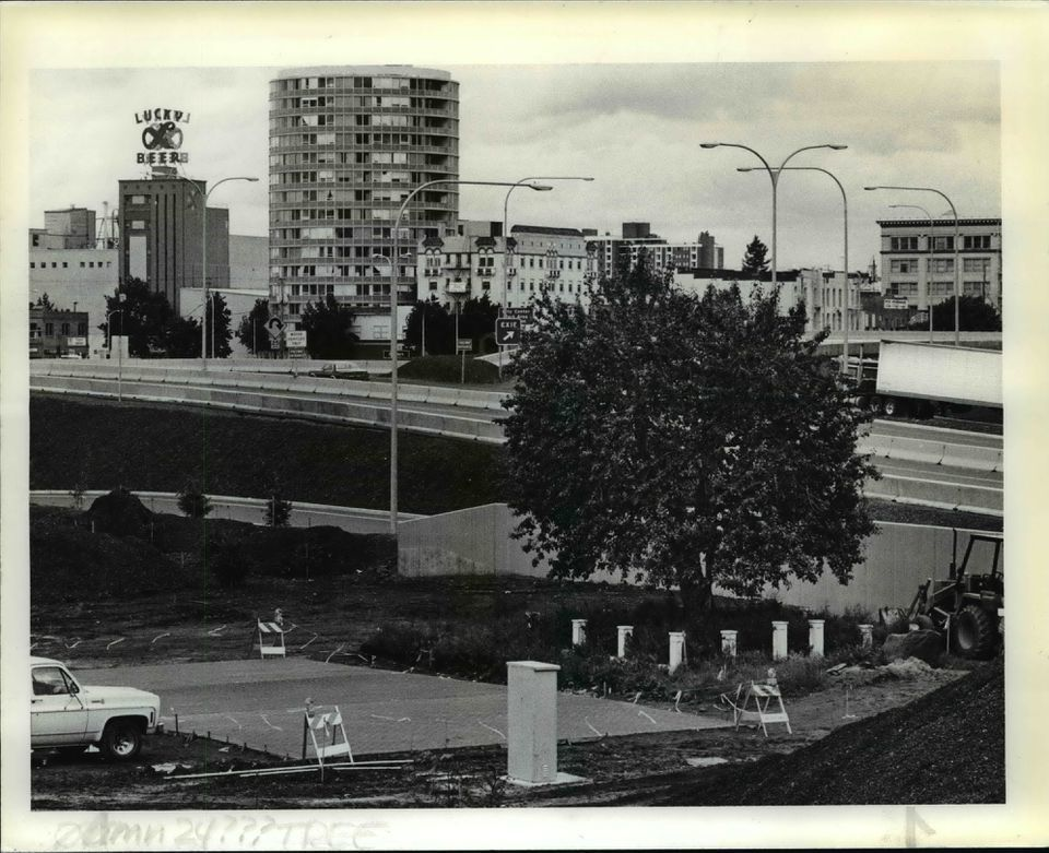In a 1984 file photo, contractors have landscaped a new park around Vancouver's Old Apple Tree. The sour apple tree, planted in 1826, sits between the Burlington Northern Railroad line on the south and the Interstate 5 overpass and cloverleaf on Washington 14 to the north. The tree was saved from bulldozers during highway reconstruction by rerouting the freeway at the cost of about $500,000.
