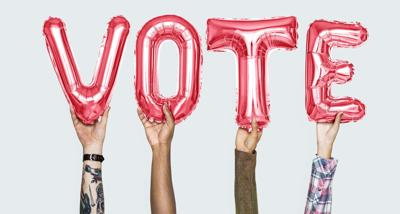 Hands holding vote word in balloon letters