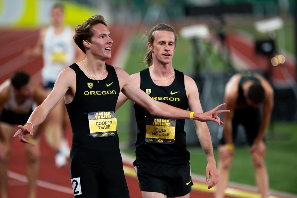 Oregon's Cooper Teare (left) and Cole Hocker look on after the men's 1,500 meters race at the Oregon Twilight track and field meet on Friday, May 7, 2021, at Hayward Field in Eugene. Photo by Timothy Healy for The Oregonian/OregonLive