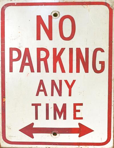 A No Parking Any Time Sign