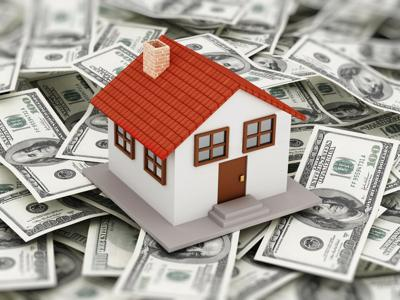 House standing on dollar pile