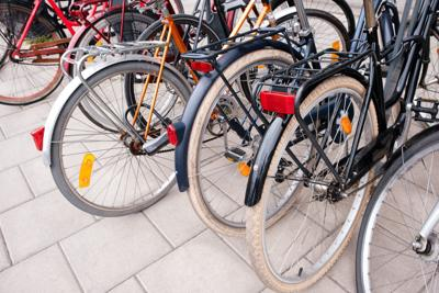 Group of bicycles parking. Sport concept with bicycle. Pile of bikes in the street of Stockholm city. Selective focus