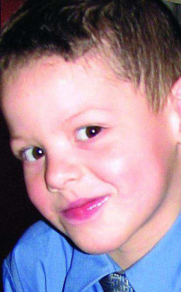 Stepfather charged as dead boy remembered