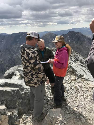 Idaho couple summit mountain for wedding